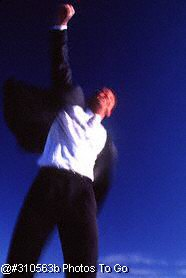 Exuberant businessman jumping in the air